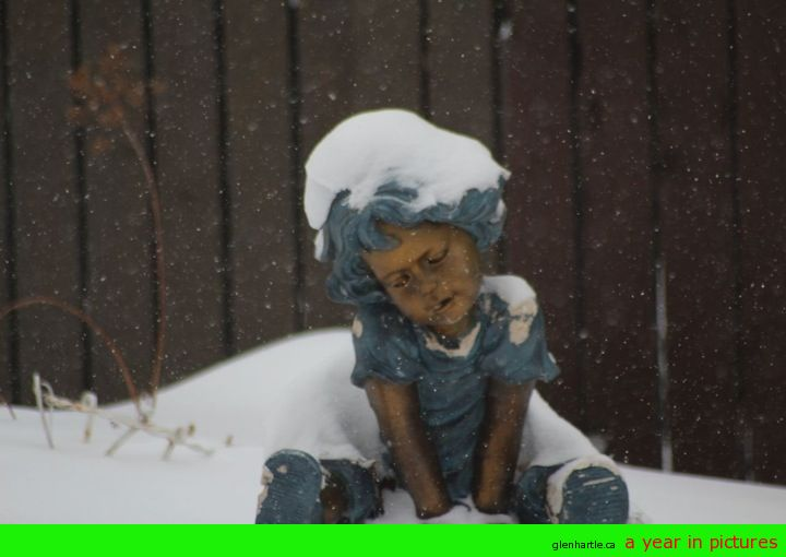 Even the statue is sad it's snowing