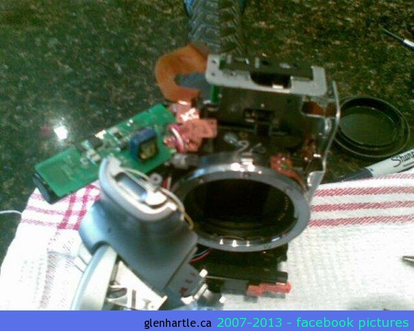 Friday – August 31  (cell phone photo)GOOD GRIEF! TRYING TO FIX MY camera…. Yikes – hope it fits back together!Here are the instructions that I was following: http://www.lotek.nu/misc/EOS_300D_sub-mirror_repairThis is how the completely disassembled camera looked AFTER the fix which I had also found on the internet.  A $3.95 set of screwdrivers, a $6.48 tube of Epoxy Gel, several hours of patient work, a couple near disasters, and …