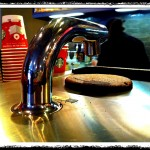 """Enter even MORE expensive coffee at Starbucks. Meet the """"Clover"""" – a reverse French press. Coming to Canada soon…? That brown clump on top is what's left over after this machine made my little cup of coffee. Looks like a brownie. But isn't. <sip, sip> hmmm….worth the extra dough…?"""