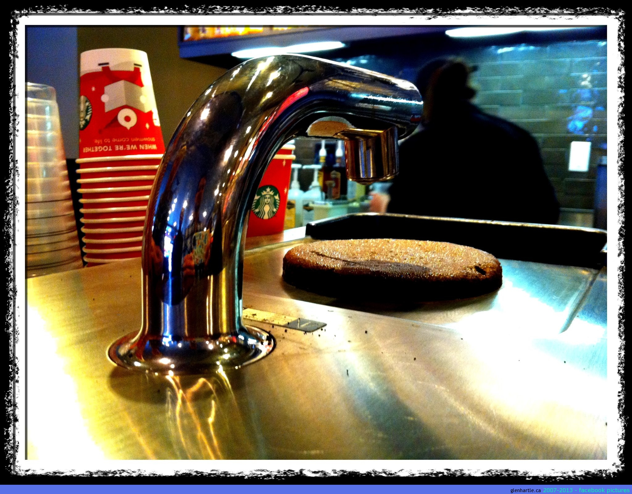 """Enter even MORE expensive coffee at Starbucks. Meet the """"Clover"""" – a reverse French press. Coming to Canada soon…? That brown clump on top is what's left over after this machine made my little cup of coffee. Looks like a brownie. But isn't.  hmmm….worth the extra dough…?"""