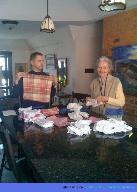 Mom & Phil folding kitchen laundry. Thought it was cute.