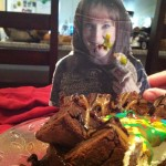 Leave the room for TWO minutes, Corina, and there you are face first in Adrian's chocolate brownie caramel cheesecake!!