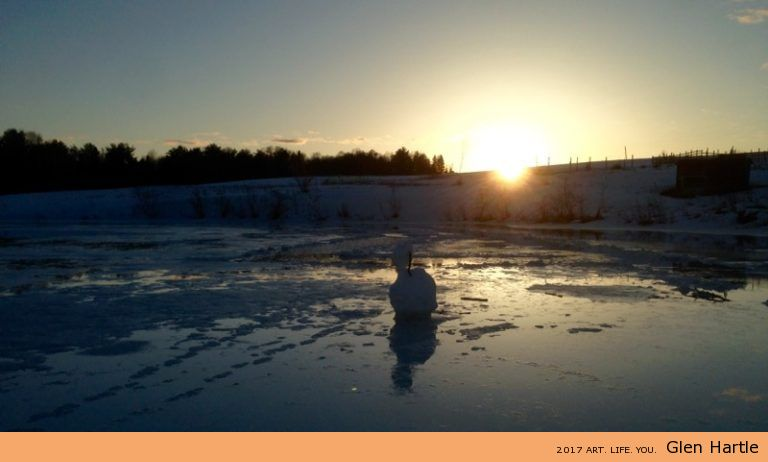 Likely one of the last sunsets Monsieur snowman will witness.