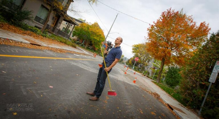 In the urban forest – the realtors even sweep the street for you while holding the photographer's camera!!